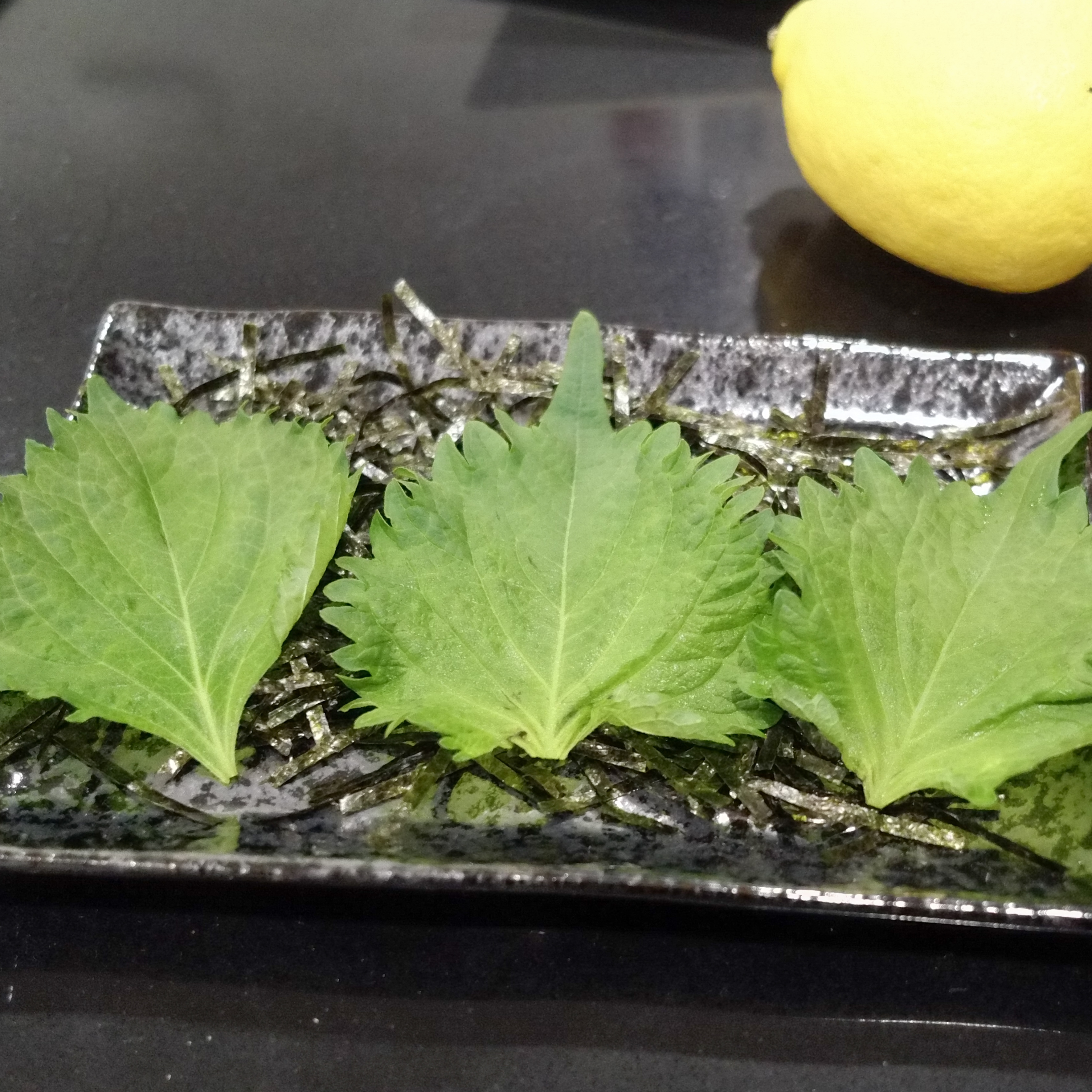 Plating the Shiso Leaves